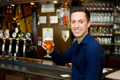 Men drinking beer at the pub Royalty Free Stock Image