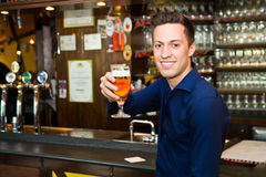 Men drinking beer at the pub Royalty Free Stock Photos