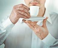 Men drinking coffee from a mug Stock Photos