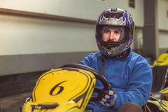 Men driving kart car with speed in a playground racing track royalty free stock images