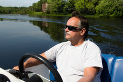 Men driving motor boat Royalty Free Stock Photography