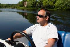 Men driving motor boat Royalty Free Stock Photography