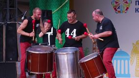 Men drummers  on open air stage stock video