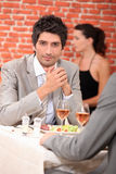 Men eating in a restaurant Royalty Free Stock Images