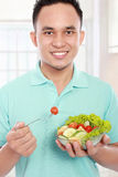 Men eating salad Stock Photography