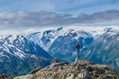 Men on the edge of Myrhyrna mountain viewing glaciers Stock Photos