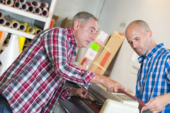 Men either side paper machine Royalty Free Stock Image