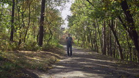 Men enjoy autumn in the forest stock footage