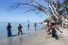 Men enjoy a game of beach volleyball on Casuarina Beach in the Jaffna region of Sri Lanka. Stock Images