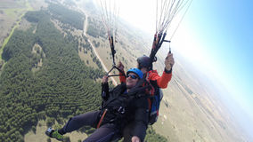 Men enjoying while paragliding Stock Photo