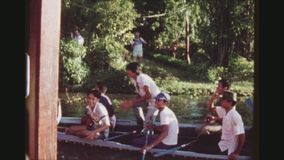 Men Enjoying Victory. THAILAND, BANGKOK, MAY 1978. Two Shot Sequence Of A Team Of Young Men Cheering Joyfully After A Boat Race On A Longboat, Holding Up And stock video footage