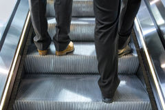 Men on a escalator Royalty Free Stock Photos