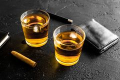 Men evening in bar with whiskey, cigar, wallet and notebook on black background Royalty Free Stock Images
