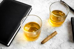 Men evening in bar with whiskey, cigar, wallet and notebook on stone bar background Royalty Free Stock Image