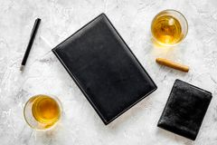 Men evening in bar with whiskey, cigar, wallet and notebook on stone bar background top view space for text Stock Photo