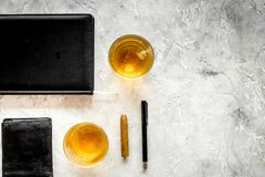 Men evening in bar with whiskey, cigar, wallet and notebook on stone bar background top view space for text Royalty Free Stock Image