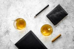 Men evening in bar with whiskey, cigar, wallet and notebook on stone bar background top view space for text Stock Image