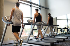 Men exercising on treadmill in gym Stock Photography