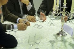 Men expect wine tasting. Royalty Free Stock Photo
