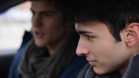 Men exploring car together sitting inside royalty free stock image