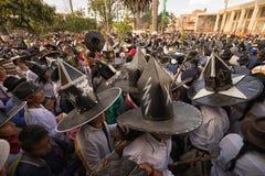 Men with extra large hats at Inti Raymi celebration royalty free stock image