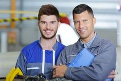 Men factor workers posing stock photo