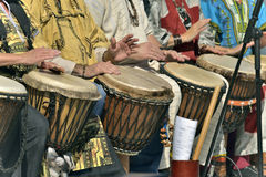 Men and famme play djembe Stock Image