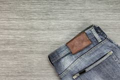 Men Fashion, Blue jeans on a brown wooden background. Color Process royalty free stock photography