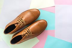 Men fashion shoe on color paper background.  Royalty Free Stock Image