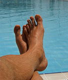 Men feet. A men's feet at the swimming pool Stock Photography