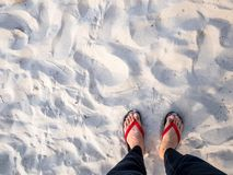 Men feet on the beautiful beach top view.Copy-space for editor. stock photography