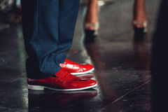 Men feet in classical pants and trendy red shoes royalty free stock photography
