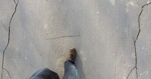 Men feet  shoes walking on the asphalt in  city stock video