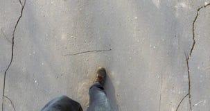 Men feet  shoes walking on the asphalt in  city stock video