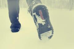 Men feet in snow. Men feet in a snowy field stock image