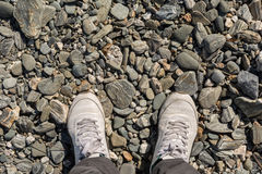 Men feet in white leather shoes Royalty Free Stock Photo
