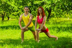 Men and female stretching muscles Royalty Free Stock Images