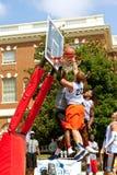 Men Fight For Ball Above Rim In Street Basketball Tournament Stock Images