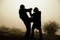Men fighting Stock Photo