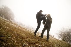 Men fighting Stock Images