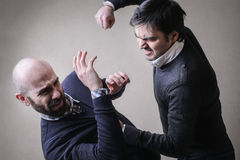 Men fighting Royalty Free Stock Photos
