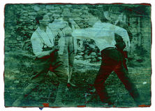 Men fighting - artistic view. This is a digital remake of an antique photo taken in the north of Italy in 1920.Two men fighting during a boxing match stock images