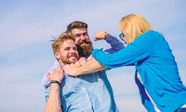 Men fighting for heart of lady. Leadership and competition concept. Man aggressive attacks lover his girlfriend. Woman. Tries stop violence, men fighting royalty free stock images