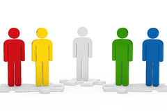 Men figure team. Colorful men team figure stand on jisaw Royalty Free Stock Photography