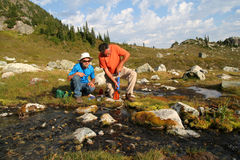 Men Filtering Water. From a mountain stream. British Columbia. Canada Stock Images