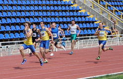 Men at the finish of the 200 meters race Stock Photo