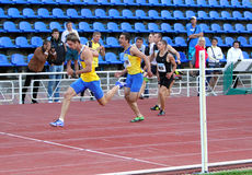Men at the finish of the 200 meters race Royalty Free Stock Image