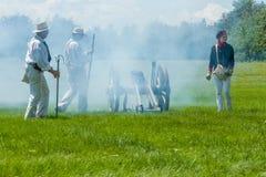 Men Firing a Canon. MORRISBURG, CANADA - JULY 14: Men firing a canon during the Battle of Crysler's Farm reenactment on July 14, 2013 near Morrisburg, Ontario Stock Image