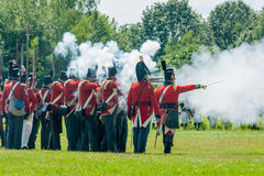 Men Firing Muskets during Reenactment Stock Photography