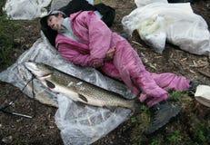 Men and fish Royalty Free Stock Image